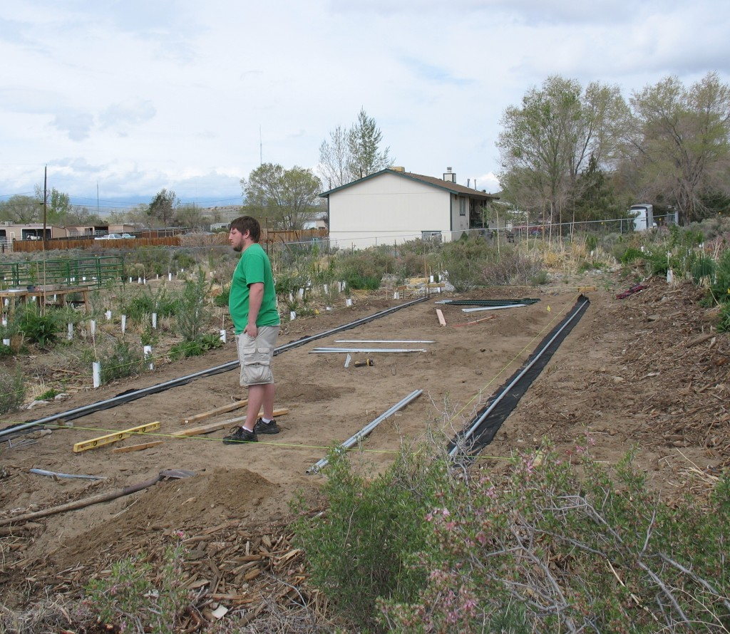 Rails being laid down before the hoophouse is placed on it. One of our great volunteers Josh Jahner in the foreground.